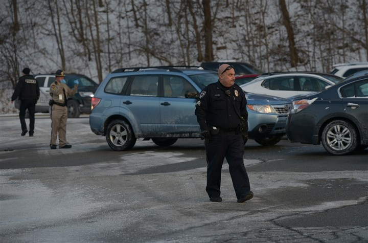20170106ppmonroevilleshooting Law enforcement officials patrol the parking lot of the Monroeville Mall by Macy's on Friday.