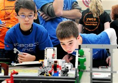 Oleg Hartman, left, and Evan Moncheck, of Providence Heights Alpha School in McCandless, keep a close eye on their robot's performance at the Western Pennsylvania FIRST LEGO League Grand Championship tournament at LaRoche College on Saturday.