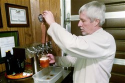Frank Kegg pours a pale ale, one of the beers he makes at Kegg Brewing Co. near Champion in Westmoreland County. He sells beers by the growler, or glass jug, on weekends.