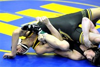Quaker Valley's John Rocco Kazalas (on top) wrestled Pine-Richland's Alex Salas in a 126-pound match at the Chartiers-Houston tournament earlier this season. The Quakers are one of two new teams to wrestle this year.