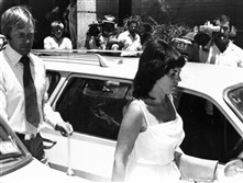 In this Feb. 2, 1982, file photo, Michael, left, and Lindy Chamberlain leave a courthouse in Alice Springs, Australia.