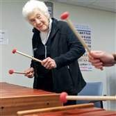 Sally Newman, 87, of Oakland plays the marimba during a new class at the University of Pittsburgh for people with mild cognitive impairment.