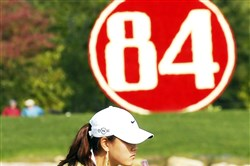 Michelle Wie eyes up her putt on the 17th hole Thursday in the first round of play of the 84 Lumber Classic at Nemacolin Woodlands Resort in Farmington.