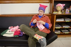 "Kitty Spangler of Lawrenceville crochets ""pussy hats,"" to be worn at the Women's March on D.C., at the Carnegie Library of Pittsburgh in Lawrencville last week. The ""pussy hats"" are being knit and crocheted by people throughout the country as a response to the leaked video where Donald Trump comments about grabbing women's genitals. Spangler will be joining friends in Washington to participate in the march the day after Donald Trump's inauguration."