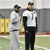 Steelers head coach Mike Tomlin and quarterback Ben Roethlisberger watch receiver drills during practice Wednesday on the South Side.
