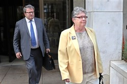 Former Pennsylvania Treasurer Barbara Hafer and her attorney, John Knorr, leave federal court in Harrisburg after her arraignment in August.