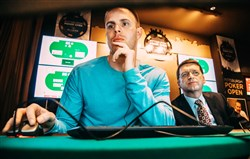 "Professional poker player Jason Les plays against ""Libratus,"" a computer program, during the Brains vs. Artificial Intelligence rematch Wednesday at Rivers Casino on the North Shore. The computer program developed at CMU by professor Thomas Sandholm, right, and his student Noam Brown uses algorithms to study the rules of poker and create its own strategy."