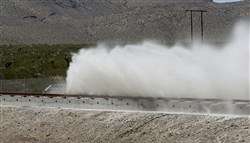 A sled speeds down a track during a test of a Hyperloop One propulsion system .