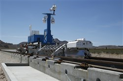 A recovery vehicle and test sled sit on a track for the Hyperloop One propulsion system in 2016 in North Las Vegas, Nev.