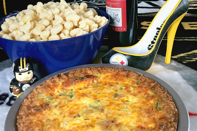 "Tater Tot Quiche and Steelers gear make for a sporty ""homegating"" buffet table."