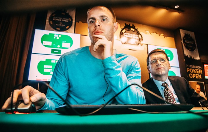 "20170111arComputerPoker02-1 Professional poker player Jason Les plays against ""Libratus,"" a computer program, during the Brains vs. Artificial Intelligence rematch Wednesday at Rivers Casino on the North Shore. The computer program developed at CMU by professor Thomas Sandholm, right, and his student Noam Brown uses algorithms to study the rules of poker and create its own strategy."