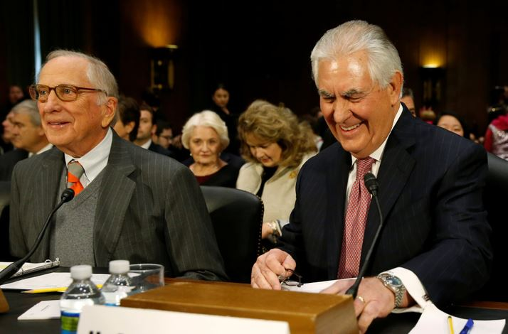 Tillerson Rex Tillerson, right, takes his seat next to former Sen. Sam Nunn, D-Ga., to testify before a Senate Foreign Relations Committee confirmation hearing on his nomination to be secretary of state in Washington.