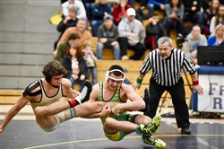 Penn-Trafford's Cameron Coy, in the green singlet, who beat Belle Vernon's Brock Godzin in the 152-pound final at the Westmoreland County tournament, saw his showdown Wednesday with Hempfield's Jarod Verkleeren aborted when Verkleeren was injured and defaulted.