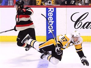 Ottawa's Mike Hoffman and the Penguins' Sidney Crosby battle during a Jan. 12 game in Ottawa.