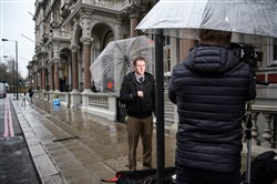 Journalists from a U.S. network broadcast from outside the headquarters of Orbis Business Intelligence, the company run by former intelligence officer Christopher Steele, on Thursday in London.