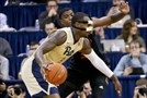 Pitt's Michael Young drives against Miami's Anthony Lawrence Jan. 14.