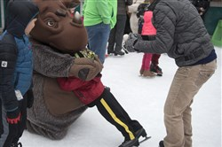 Amauri Sanders, 3, loses his footing while greeting the rhino mascot of the Pittsburgh Zoo as his aunt, Darlene Tokarsky, laughs during the Mascot Skate at the Schenley Park Ice Skating Rink in Oakland on Jan 14, 2017.  It was only Sanders' second time skating.
