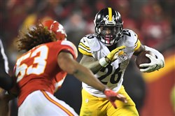 Le'Veon Bell rushes against the Chiefs Sunday night in Kansas City, Mo.