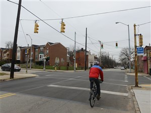 A bicyclist rides down Hamilton Avenue near the intersection of North Homewood Avenue on Sunday in Homewood. Pittsburgh's Urban Redevelopment authority has received a state grant that will allow it to make sidewalk and intersection improvements in Homewood in a rectangle bounded by Braddock and Homewood avenues, from the East Busway to Hamilton Avenue.