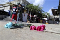 Roses lay outside the Blue Parrot nightclub after a shooting in Playa del Carmen, Mexico, on Monday.