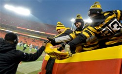 Steelers fans reach to shake hands with wide receiver Eli Rogers before his team takes on the Chiefs.