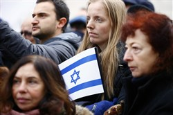Pro-Israel demonstrators listen to speeches during a gathering Sunday in front of Israeli Embassy in Paris.