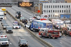 Emergency personnel work at the scene of a fatal multivehicle crash in December on the Bronx Expressway in New York.