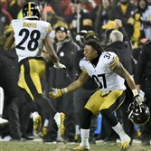 Jordan Dangerfield congratulates Sean Davis after Davis broke up a two-point conversion attempt in the fourth quarter Sunday to help the Steelers advance to the AFC championship.