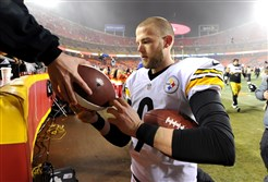 Kicker Chris Boswell signs autographs after kicking six field goals against the Chiefs to win Sunday at Arrowhead Stadium.