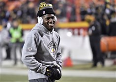 Steelers wide receiver Antonio Brown acknowledges fans as he warms up at Arrowhead Stadium Sunday before his team's win against the Chiefs.
