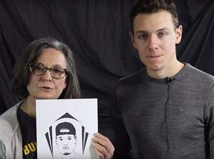 """In a still image taken from a video, Jody Guy and Ben Fiorillo fundraise for the """"Portrait Project: Faces from Within"""" to advocate for proper healthcare for the incarcerated."""