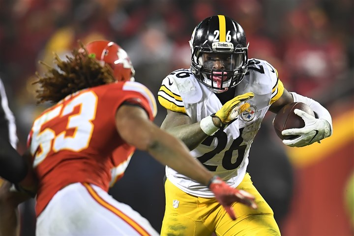 20170115pdSteelersSports05-4 Le'Veon Bell picks up yardage during an AFC divisional-round playoff game against the Chiefs.