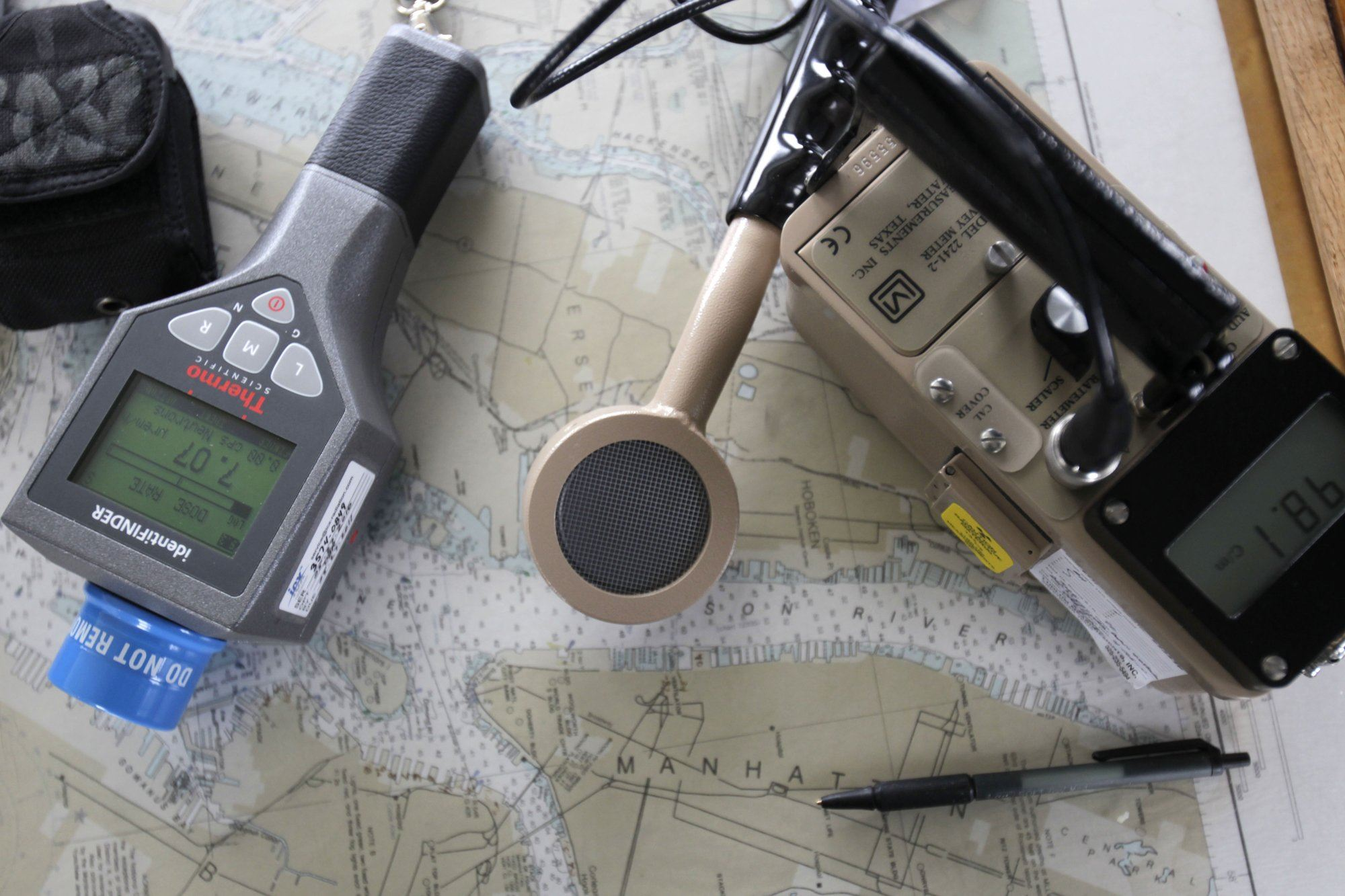 "AP_110407074738-3 This April 7, 2011, file photo shows instruments for detecting radiation, resting on a map of the New York area during an exercise to intercept radioactive ""dirty bombs"" in waterways near New York."
