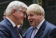 German Foreign Minister Frank-Walter Steinmeier, left, talks with British Foreign Secretary Boris Johnson during an EU foreign ministers meeting at the EU Council in Brussels on Monday.