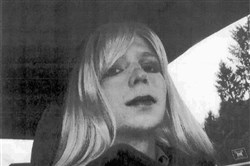 In this undated file photo provided by the U.S. Army, Pfc. Chelsea Manning poses for a photo wearing a wig and lipstick. On Tuesday, President Barack Obama commuted the sentence of Chelsea Manning, who leaked Army documents and is serving 35 years.