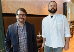 Owner Brian Keyser, left, and executive chef Andrew Hill at Casellula, the restaurant at City of Asylum's Alphabet City, on the North Side. It has transitioned to tipping.