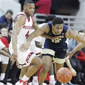 North Carolina State's Dennis Smith Jr. and Pitt's Chris Jones go for a loose ball Tuesday in Raleigh, N.C.