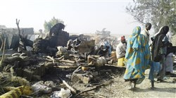 The aftermath of an airstrike Tuesday that accidentally hit a camp for displaced people, killing dozens, in Rann, Nigeria.