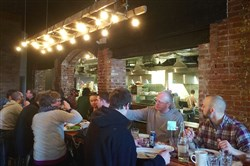 A group enjoys brunch at Smallman Galley, the restaurant incubator/food hall in the Strip District.