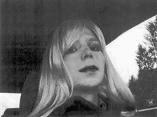 In this undated file photo provided by the U.S. Army, Pfc. Chelsea Manning poses for a photo wearing a wig and lipstick. On Tuesday President Barack Obama commuted the sentence of Manning, who leaked Army documents and is serving 35 years in prison.