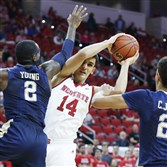 North Carolina State's Omer Yurtseven pulls in a rebound as away from Pitt's Michael Young in the first half Tuesday in Raleigh, N.C.