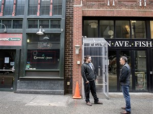 Jared Kelley, left, general manager of Courthouse Tavern, and Mike Clements, landlord of Penn Ave Fish Co., talk about their shared situation of being forced to closed due to sewer backups.