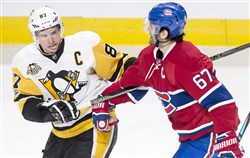 Penguins center Sidney Crosby gets tangled up with Montreal's Max Pacioretty during the second period Wednesday.