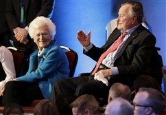 In this Feb. 25, 2016, file photo, former President George H.W. Bush, right, and his wife, Barbara, are greeted before a Republican presidential primary debate at The University of Houston in Houston.