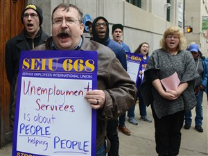 Randy Almond of Lincoln Place and several other SEIU 668 members and community advocates rally outside the Pennsylvania CareerLink office Thursday.