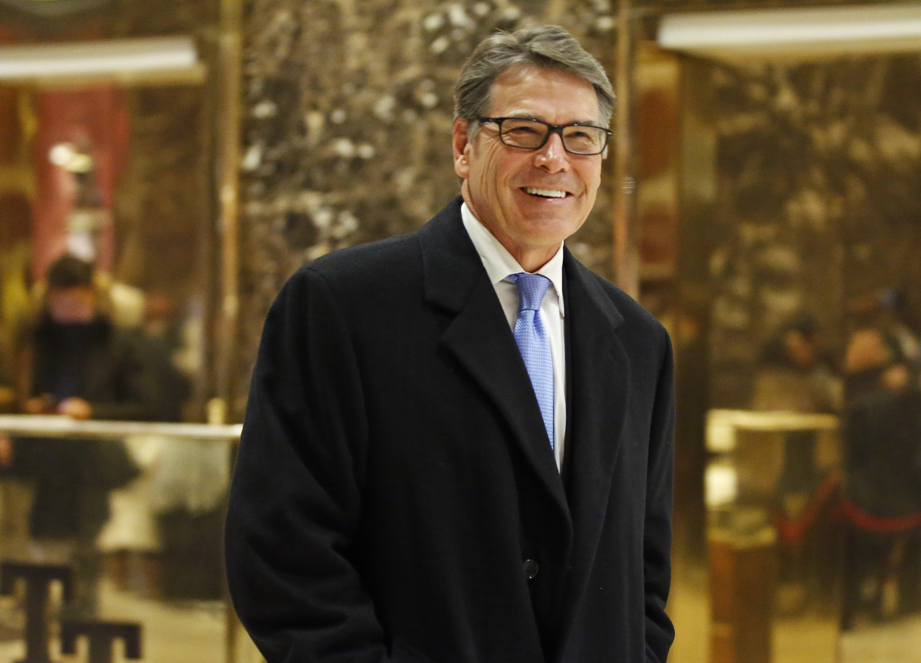 """Trump Energy Secretary FILE - In this Dec. 12, 2016, file photo, former Texas Gov. Rick Perry smiles as he leaves Trump Tower in New York. Perry was for """"all of the above"""" on energy production before President Barack Obama embraced the strategy. Years before the Democratic president endorsed all types of energy production _ from oil and gas to renewable sources like wind and solar power _ Perry was putting the policy into practice in Texas. (AP Photo/Kathy Willens, File)"""