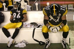 Hines Ward, left, and Marvel Smith sit on the bench after the team's 41-27 loss to the New England Patriots in the AFC championship in January 2005.
