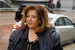 Abby Lee Miller walks along Grant Street toward the federal courthouse for a hearing in January.