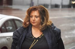 "Abby Lee Miller arrives at the Federal Courthouse in Pittsburgh.  Miller, of ""Dance Moms,"" plead guilty to charges she concealed assets from her TV show from bankruptcy court and sneaked $120,000 into the U.S. in plastic Ziploc bags that members of her entourage tucked into their luggage after a dance trip to Australia."
