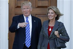 President Donald Trump and his nominee for education secretary, Betsy DeVos